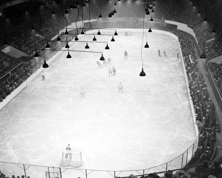 Hockey from the 1937 Detroit Olympia - no side glass so spectators could lean over the boards and watch the game!