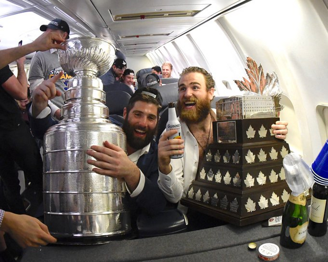 O'Reilly with the Conn Smythe on the plane back to St. Louis